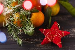 Merry Christmas and Happy Holidays! Red star, Christmas baubles Stock Photos