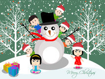 Merry christmas with happy kids and snowman Royalty Free Stock Photos