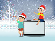 Merry christmas with happy kids and tablet Stock Images
