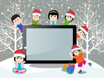 Merry christmas with happy kids and tablet Stock Photo