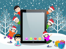 Merry christmas with happy kids and tablet Royalty Free Stock Image