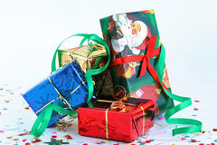 Merry Christmas and Happy New Year!. Boxes with gifts in celebratory packing over white Stock Photos
