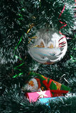 Merry Christmas and Happy New Year!. White celebratory sphere  and boxes with gifts in celebratory packing on a New Year's tree Stock Image