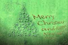 Merry christmas and happy new year 2012. Background and text fir Christmas greeting in gold Royalty Free Stock Image