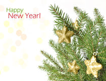 Merry Christmas and happy New Year. Fir tree branches decorated with stars isolated on white background Stock Photos