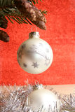 Merry christmas and a happy new year. Silver colored christmas balls in front of a red background royalty free stock photo