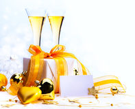 Merry Christmas and happy new year. Christmas greeting card ( glasses of champagne vine and Christmas gifts, New Year party Royalty Free Stock Photos