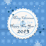 Merry Christmas and a Happy New Year. Blue background with white snowflakes and a rounded white element on which is written the text Merry Christmas and a Happy Royalty Free Stock Photo