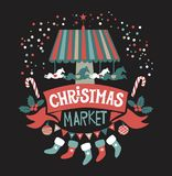 Christmas market poster. Merry Christmas and Happy New Year on amusement park, winter market, festival, fair. Hand-lettering Christmas market on the red ribbon Royalty Free Stock Image