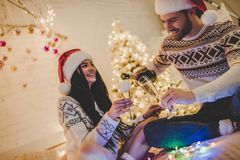 Couple celebrating New Year at home stock image