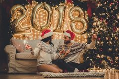 Couple celebrating New Year at home stock photo