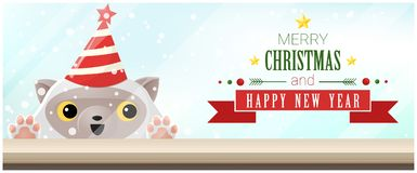 Merry Christmas and Happy New Year background with cat looking at empty table top Royalty Free Stock Image
