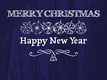 Merry Christmas and Happy New Year background. Merry Christmas and Happy New Year dark blue greeting card, vintage background with christmas balls, bell and Royalty Free Stock Image