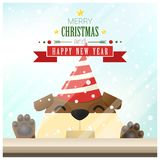 Merry Christmas and Happy New Year background with dog standing behind window Stock Photo