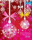 Merry Christmas and Happy New Year background. With fir branches and the color full snow with decorations on the red background. Royalty Free Stock Image
