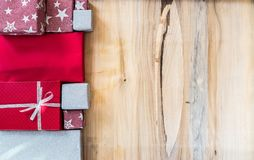 Merry Christmas and Happy New Year background. Merry Christmas and Happy New Year, winter season. Gift boxes and copy space for text on wood background Stock Images