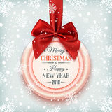 Merry Christmas and Happy New Year 2018 badge. Merry Christmas and Happy New Year 2018 badge, with red ribbon and bow on winter background with snow and Royalty Free Stock Photo