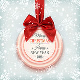 Merry Christmas and Happy New Year badge. Merry Christmas and Happy New Year badge, with red ribbon and bow on winter background with snow and snowflakes Stock Photography