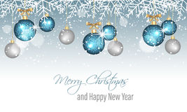 Merry Christmas and Happy New Year banner with snowflakes, snow, blurred circles, blue and silver hanging bauble. Royalty Free Stock Photo