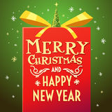 2017. Merry Christmas and Happy New Year. Beautiful inscription on the big red gift with gold ribbon. Vector illustration Vector Illustration