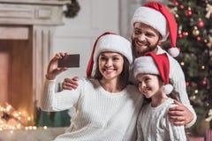 Family celebrating New Year Royalty Free Stock Images