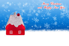 Merry Christmas and Happy New Year blue background with Christmas toy in the form of a house Royalty Free Stock Photo