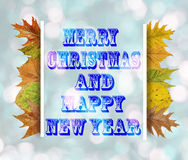 Merry Christmas And Happy New Year on blue bokeh background Stock Photos