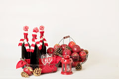 Merry Christmas and happy New year. Bottles of wine in a knitted Stock Images