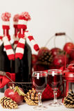 Merry Christmas and happy New year. Bottles of wine in a knitted Stock Image