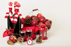 Merry Christmas and happy New year. Bottles of wine in a knitted Stock Photography