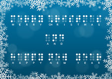 Merry Christmas and Happy New Year card with braille greeting. In snowframe on dark blue background with bokeh effect Stock Images