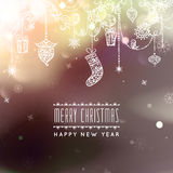 Merry Christmas and Happy New Year card. Christmas typographic message. Vector bokeh background, festive defocused. Lights, snowflakes, bauble, hanging Stock Image