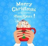 Merry christmas and happy new year card with hands holding cute. Cartoon red cup with hot drink decorating with sparkler and cream on snowy background. Vector vector illustration