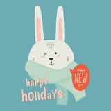 Merry Christmas and Happy New 2017 Year Card. With Happy Smiling Xmas White Bunny with Greeting Bubble wish on Blue Background. Greeting holidays lovely card Stock Image