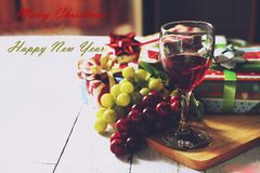Merry Christmas and Happy New Year celebrate. On white table with persents Stock Images