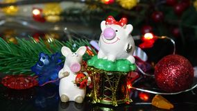Toy pig and winter decor, congratulations on the holiday. Symbol of the year of the pig on the background of Christmas royalty free stock photo