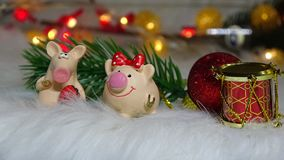 Toy pig and winter decor, congratulations on the holiday. Symbol of the year of the pig on the background of Christmas royalty free stock photos