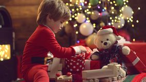 Merry Christmas and Happy new year. Christmas Celebration holiday. Christmas decorations. Models child having fun with stock footage