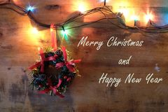 Merry Christmas and Happy New Year, Christmas garland and lights Royalty Free Stock Photography