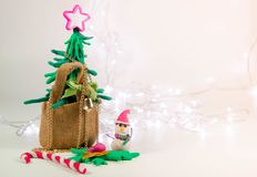 Clay christmas tree in bag near area space ,Christmas background with festive decoration with led light Royalty Free Stock Photo