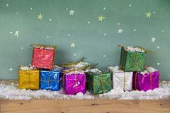 Merry christmas Happy new year. Colorful gift box. On snow wooden floorand and scene green board background space leave blank for writing greetings and Have Royalty Free Stock Images