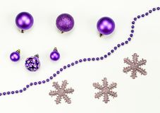 Merry Christmas and Happy New Year composition and decorations: Christmas toys, chaplet, snowflakes royalty free stock image