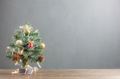 Merry Christmas & Happy new year concept background.Close up beautiful Christmas tree with decoration & ornament on modern rustic. Brown wooden at home office Royalty Free Stock Photo