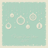 Merry Christmas and Happy New Year. Cover design for the new year. Depicts Christmas decorations with symbols of the new year:Christmas tree, snowflake. The Royalty Free Stock Photos