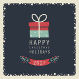 Merry Christmas and Happy New Year. The cover design. The depicts a gift box, phrase happy  christmas holidays on a dark background.The depicts a number 2,0,1,7 Stock Photo