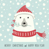 Merry Christmas and Happy New Year. The cover design. Depicts a polar bear in a cap and scarf in red. Mouth bear holding a twig with red berries. The phrase Royalty Free Stock Photos