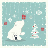 Merry Christmas and Happy New Year. The cover design. Depicts a seated little polar bear. A garland of snow balls, christmas toys, gift box, snowflakes and Stock Images