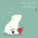 Merry Christmas and Happy New Year. The cover design. Depicts a seated little polar bear with gift box. A garland of snow balls over a bear and the phrase merry Royalty Free Stock Images