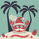 Merry Christmas and Happy New Year. The cover design. Christmas on the island. Depicts two palm trees, a crab in Santa Claus hat, garlands of snowflakes Royalty Free Stock Photo