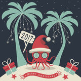 Merry Christmas and Happy New Year. The cover design. Christmas on the island. Depicts two palm trees, a octopus in Santa Claus hat, garlands of snowflakes Stock Photos